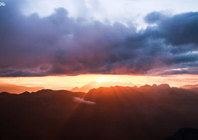 sexten - clouds - dolomites - sunlight - red - mountains - power - love